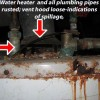 Water heater rusted; vent hood disconnected and indications of spillage